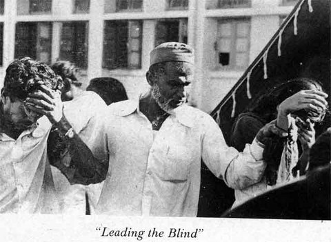 Bhopal 1984 A man leading a blinded couple