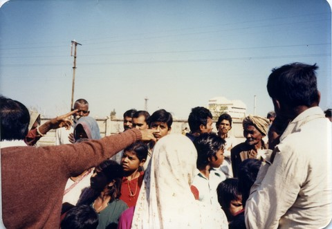 Bhopal 1985 people pointing at the smoke stacks of Union Carbide plant
